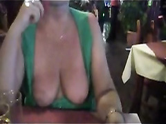 Mature wife takes her tits out at the bar