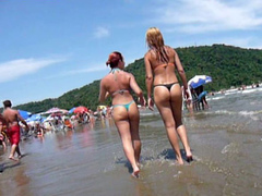 Filming sweet beach asses in thongs