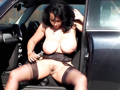 Milf demonstrates vintage stockings and big tits outdoors