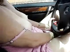 I caught my wife flicking the clit as she drives her favorite car