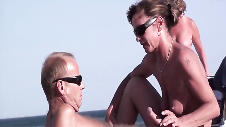 Wife sucks and strokes my friend's dick at the beach