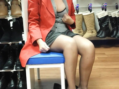 Busty goddess in stockings rubs her pussy in the shoe store