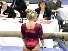 Female gymnast with a powerful ass in a shiny leotard