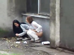 Two teens are filmed taking a piss together