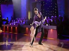 Flexible dancer babe in a pretty purple dress