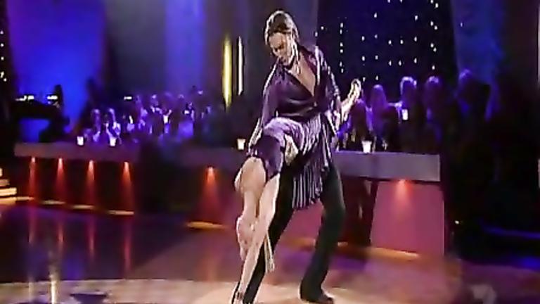 Flexible dancer babe in a pretty purple dress