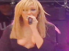 Incredible cleavage on a sexy singing lady