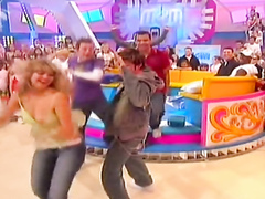 Tits pop out dancing on a TV show