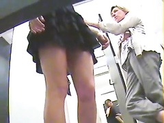 Hidden cam upskirt of cutie trying on dresses