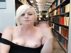 Pretty blonde stimulates herself in the library
