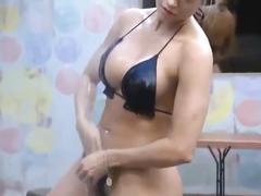 Bikini cutie washes her crotch in the shower