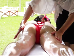 Adorable Asian bikini girl gets an oil massage