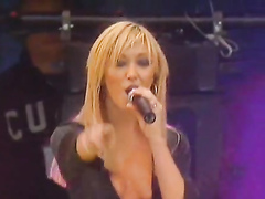 Sexy singer nearly exposes her little tits