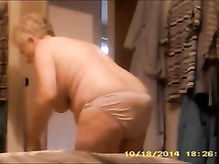 Fat grandma walks around the house naked