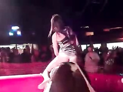 Mechanical bull riding hottie flashes her panties