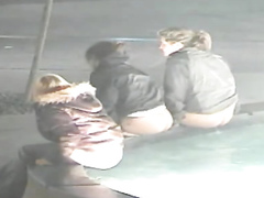 Three stoned girls peeing in a public fountain