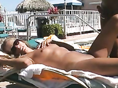 Poolside blowjob and sex at a nudist resort