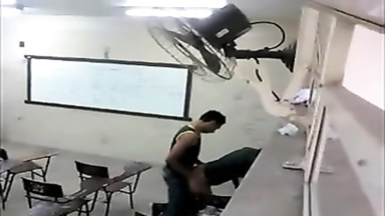 Doggystyle quickie in a lecture hall caught on camera