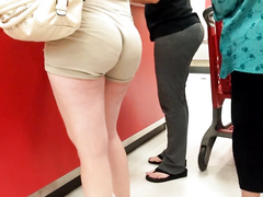 Khaki shorts fit her ass like a second skin