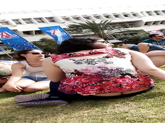 British chick sitting in the grass flashes her ass cracking