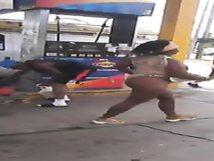 Ebony woman exposes her curves at the gas station