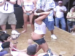 Flirtatious party chicks dancing in wet shirts