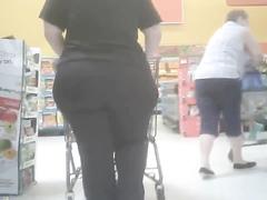 Escorting her humongous butt cheeks