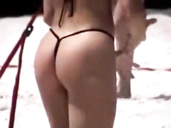 Amazing athletic ass on a beach volleyball player