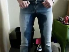Blue tight jeans get wet with her warm piss