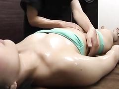 Cute model in a tube top bikini gets an oily rubdown