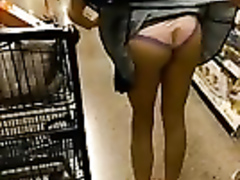 Succulent babe flashes with her cute ass