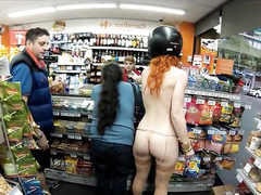 Naked ginger girl goes shopping at the gas station