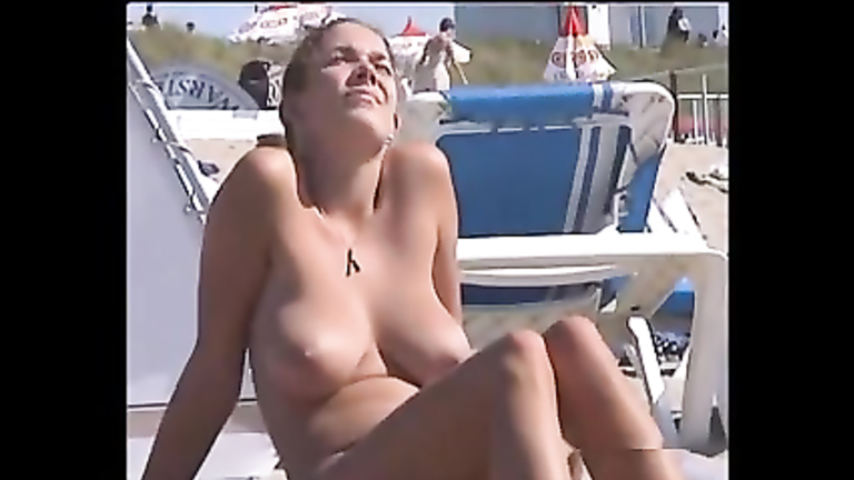Big natural boobs are amazing at the beach