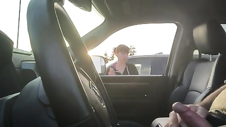 Smoking woman watches him jerk off in the car