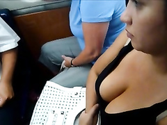 Big tits in a tank top on a busy train