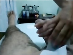 Waxing woman wanks him to an orgasm