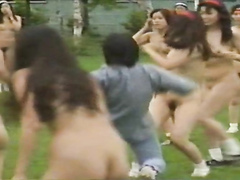 Naked Asian girls play soccer with the guys