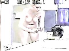 Blonde undresses in her bathroom