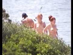Topless girls at the beach spied on
