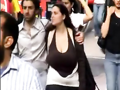 Braless girlfriend walking down the street and being filmed