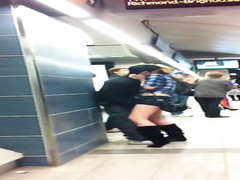Fooling around with his GF at the metro stop