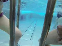 Charming girlfriend gives an underwater handjob