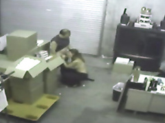 Boss blows the warehouse worker on security camera