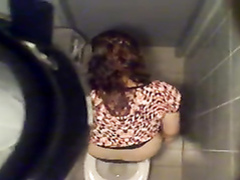 Spying on a cutie pissing in the public toilet