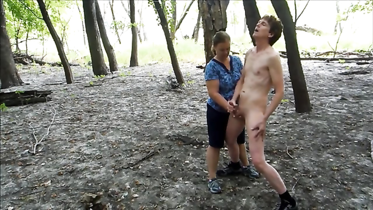 Mature woman enjoys young cock in the woods for money