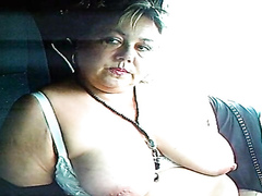 Middle-aged bimbo receives a facial cumshot