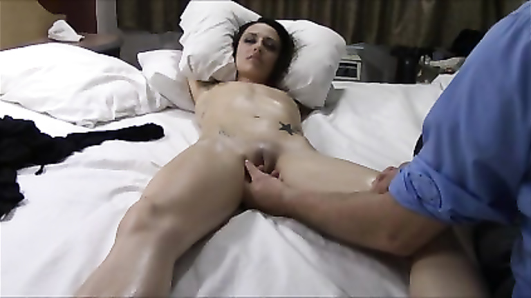 Tight naked chick fingered in a hotel bed