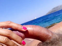 Cock stroking on a beautiful day at the ocean