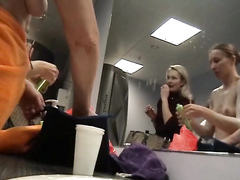 Naked blonde cutie at the locker room mirror
