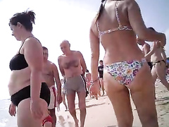 Nice breasts and ass on a female beachgoer